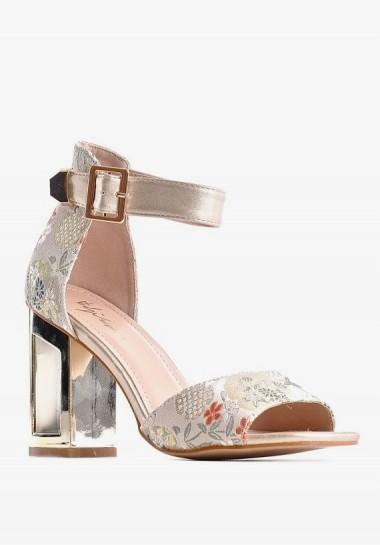 Eleganckie sandały damskie na złotym słupku